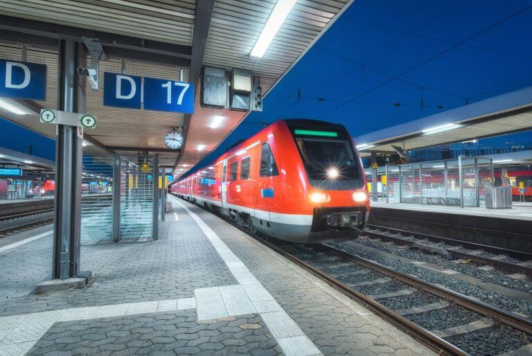 High speed train on the railway station at night
