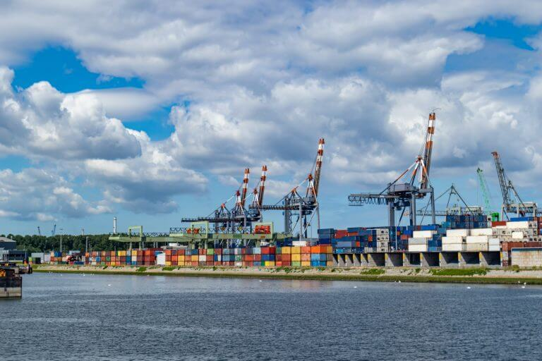 Logistics business at harbor of Rotterdam, Netherlands. Cranes and cargo loading unloading